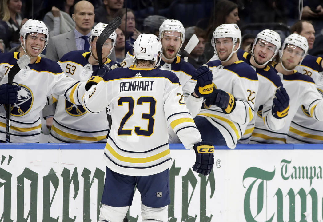 Buffalo Sabres center Sam Reinhart (23) celebrates with teammates on the bench after scoring against the Tampa Bay Lightning during the first period of an NHL hockey game Thursday, Nov. 29, 2018, ...