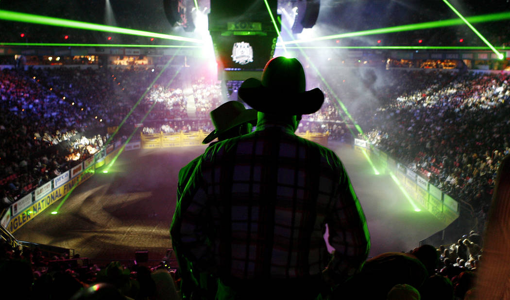 Cowboys file into the Thomas & Mack Center during the opening ceremonies of the fourth go-round of National Finals Rodeo at the Thomas & Mack Center in Las Vegas on Sunday, Dec. 9, 2007. (Issac Br ...