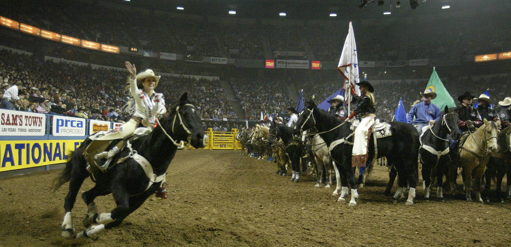 Miss Rodeo America 2007, 21-year-old Ashley Andrew waves to the crowd while racing around the arena during the opening ceremony for round four of the 48th annual National Finals Rodeo at the Thoma ...