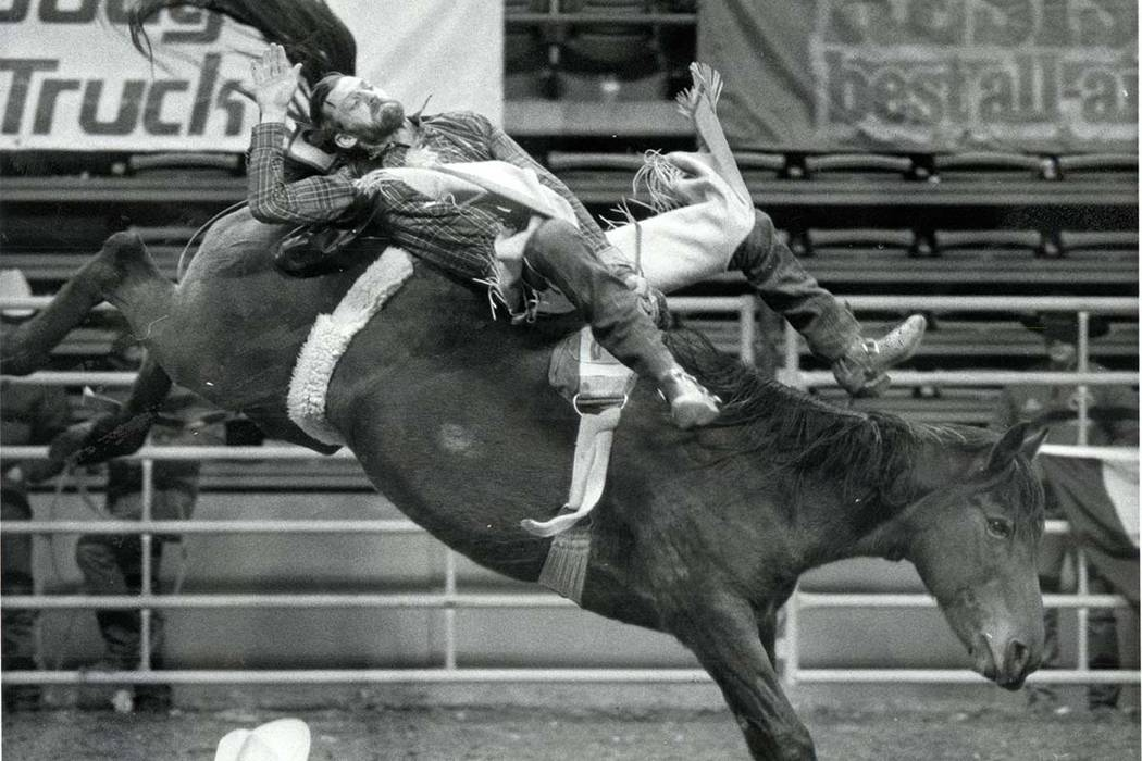 Mickey Young competes in Bareback Riding during the NFR, December 12, 1985. (Wayne Kodey/Las Vegas Review-Journal)