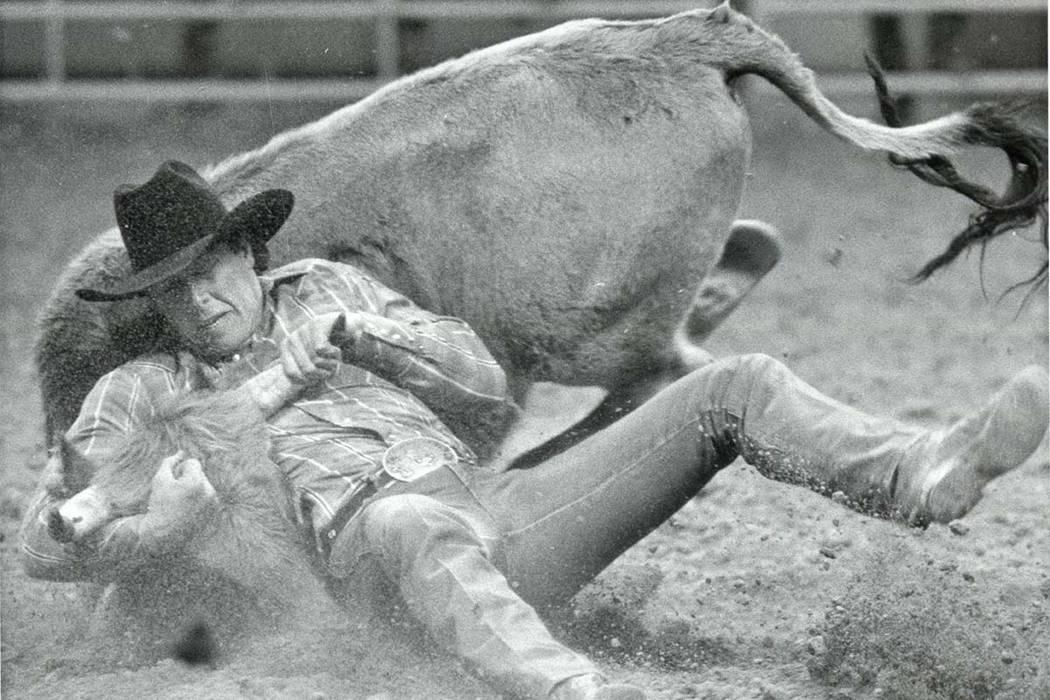Marty Melvin competes in Steer Wrestling at NFR on December 16, 1985. (Wayne Kodey/Las Vegas Review-Journal)