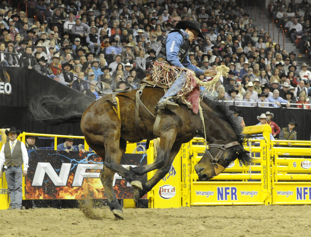 Saddle Bronc rider Jesse Wright of Milford, Utah rides Frontier Rodeo stock contractor's Let Er Rip to a score of 87.00 during the saddle bronc competition during the third round of the 54th Wrang ...
