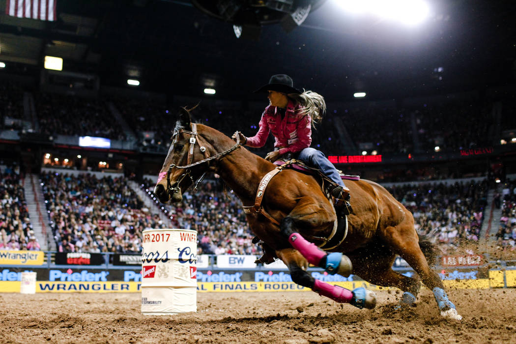 Stevi Hillman of Weatherford, Texas turns a corner in the barrel racing event during the fifth night of the 59th Wrangler National Finals Rodeo at the Thomas & Mack Center in Las Vegas, Monday ...