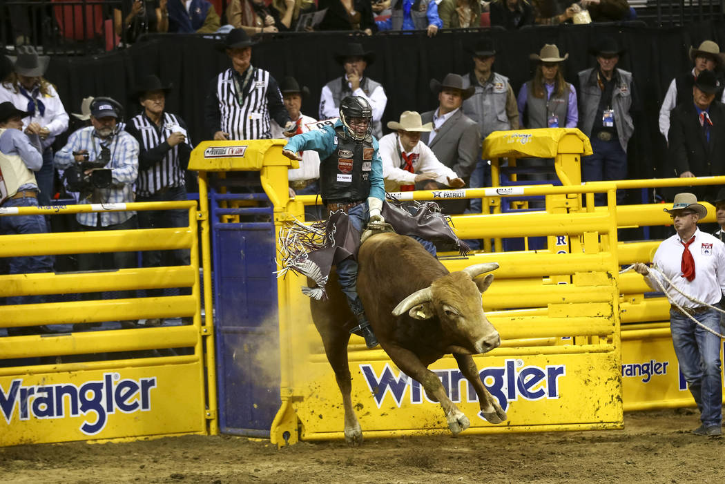 Ty Wallace of Collbran, Colorado rides Hard Knox in the bull riding competition in the tenth go-round of the National Finals Rodeo, Saturday, Dec. 16, 2017, at the Thomas & Mack Center in Las ...