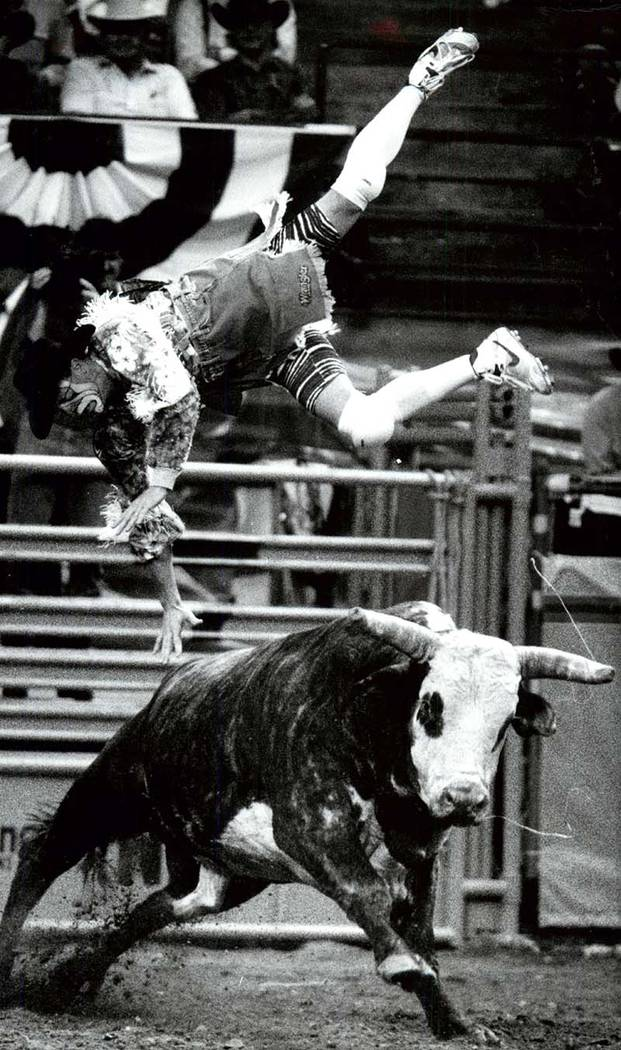 A clown flies over a bull at the NFR in Las Vegas in 1992. (File photo/Las Vegas Review-Journal)