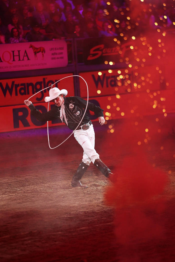 A trick roper performs before the start of the 9th performance at the National Finals Rodeo at the Thomas & Mack Center in Las Vegas Friday, Dec. 14, 2012. (Chase Stevens/Las Vegas Review-Journal)