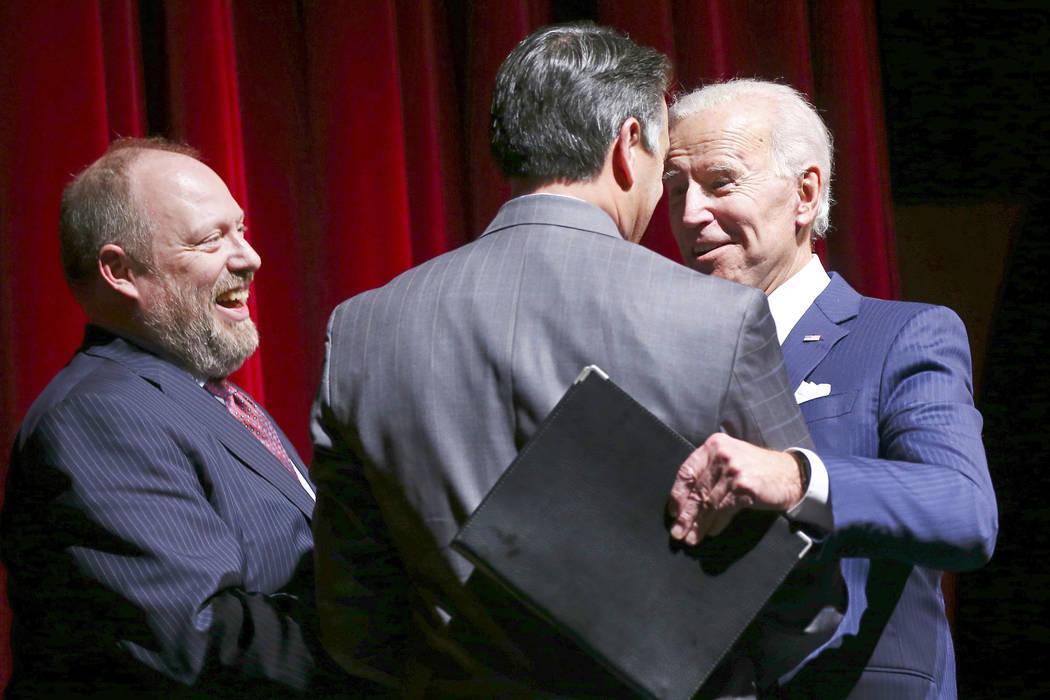 Former Vice President Joe Biden, right, greets Gov. Brian Sandoval alongside Daniel Hamilton, dean of the Boyd Law School, left, during the UNLV Law Gala at the Bellagio in Las Vegas on Saturday, ...