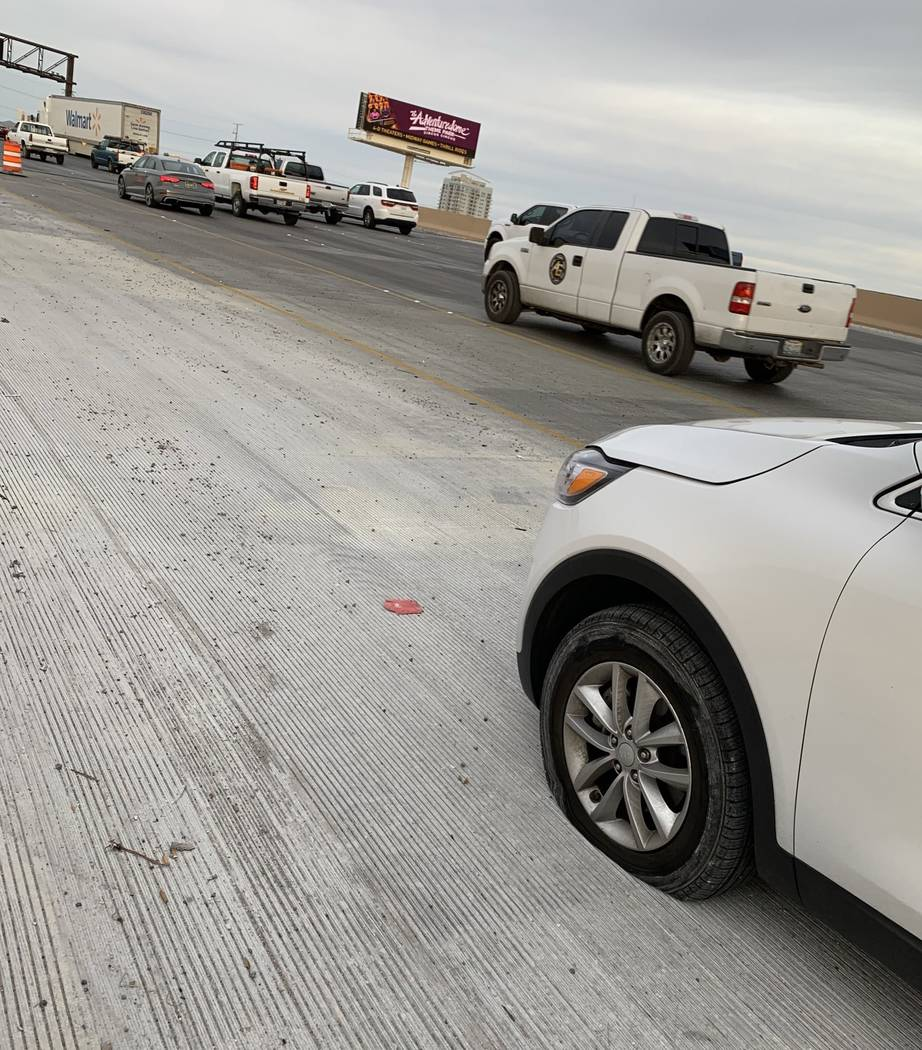A flat tire caused by a auto part on Interstate 15 northbound near downtown Las Vegas. Mick Akers/Las Vegas Review-Journal.
