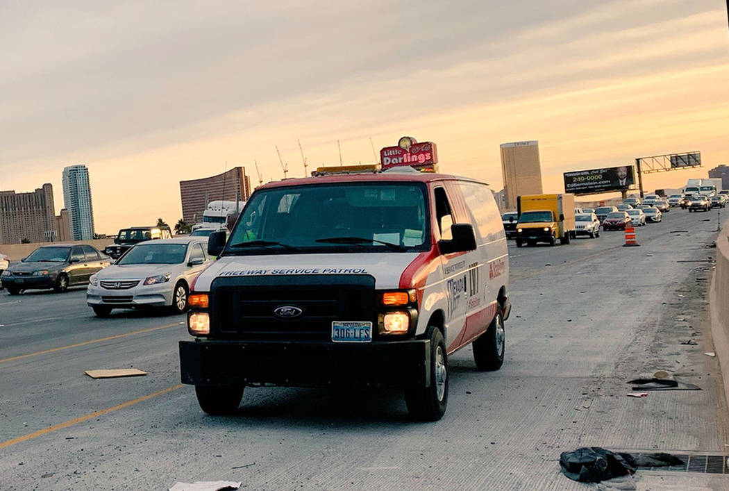 The Nevada Department of Transportation Free Way Service Patrol assists a motorist, Tuesday, Nov. 27, 2018, on Interstate 15 northbound near downtown Las Vegas. (Mick Akers/Las Vegas Review-Journal)