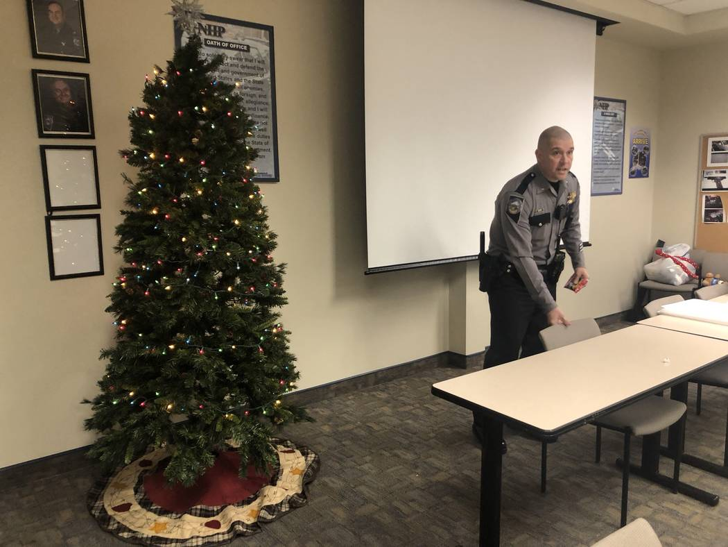 Nevada Highway Patrol Lt. Anthony Munoz at the patrol's southern command graveyard shift briefing late Friday, November 31, 2018. Munoz introduced troopers to this year's Life Saving Tree, a Chris ...