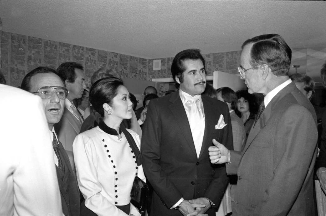 U.S. Vice President George H. W. Bush speaks with Wayne Newton and his wife Elaine Okamura after speech at the Imperial Palace October 23, 1982, in Las Vegas. CREDIT: Las Vegas News Bureau