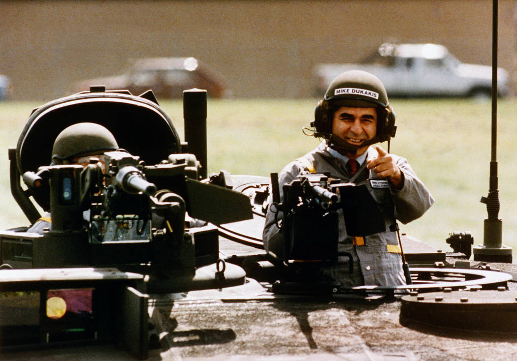 FILE - In this Sept. 13, 1988, file photo Democratic presidential candidate Michael Dukakis gets a free ride in a new M1-A-1 battle tank during a visit to General Dynamics in Sterling Heights, Mi. ...