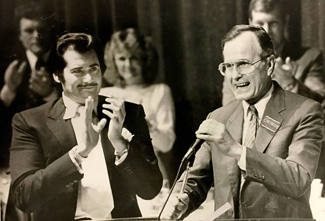 This Oct. 23,1982, file photo shows Wayne Newton, left, and George H.W. Bush in Las Vegas.