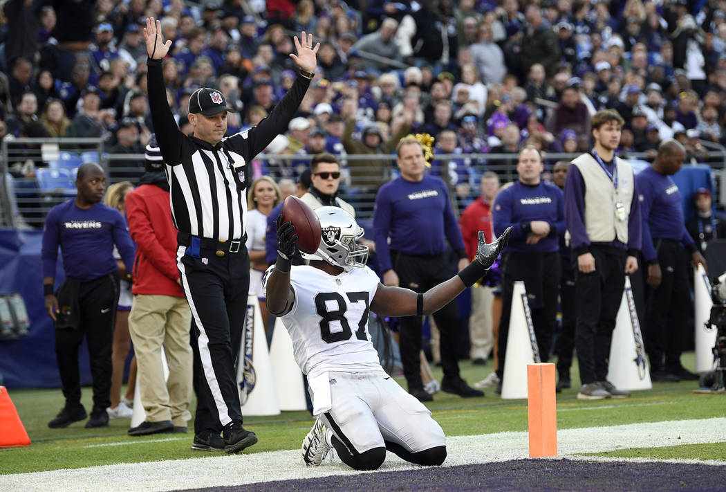Oakland Raiders tight end Jared Cook (87) gestures after scoring a touchdown in thesecond half of an NFL football game against the Baltimore Ravens, Sunday, Nov. 25, 2018, in Baltimore. (AP ...