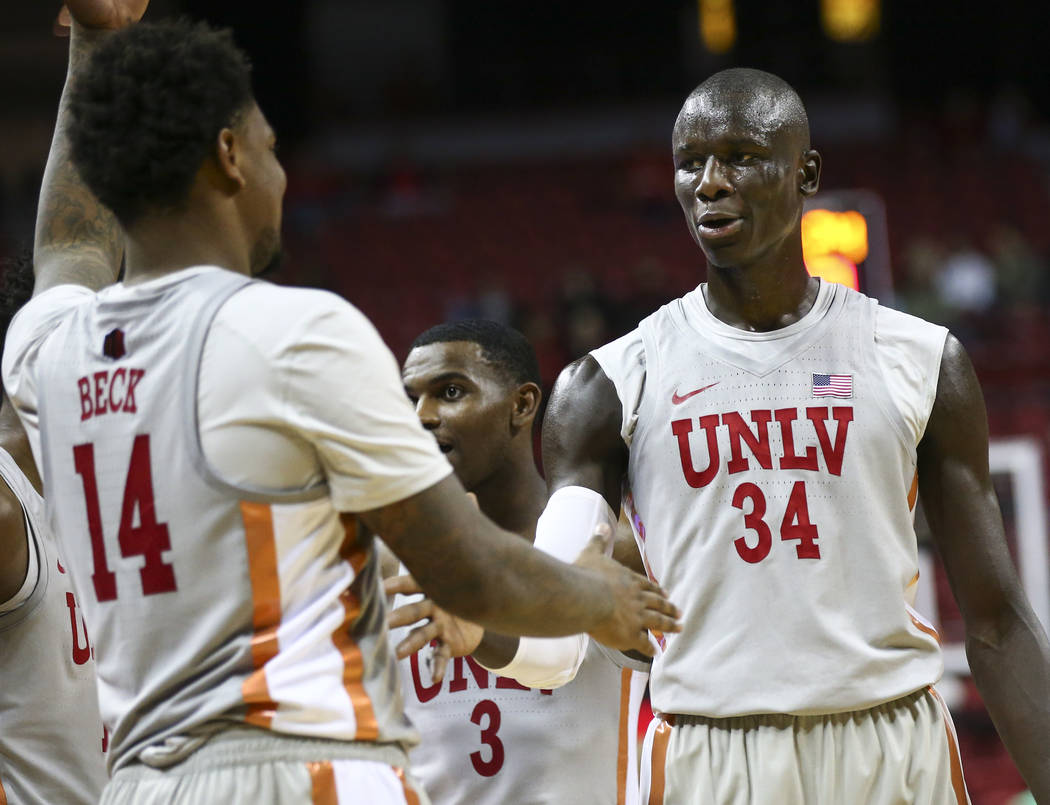UNLV Rebels forward Mbacke Diong (34) high-fives forward Tervell Beck (14) during the second half of a basketball game against the UC Riverside Highlanders at the Thomas & Mack Center in Las Vegas ...