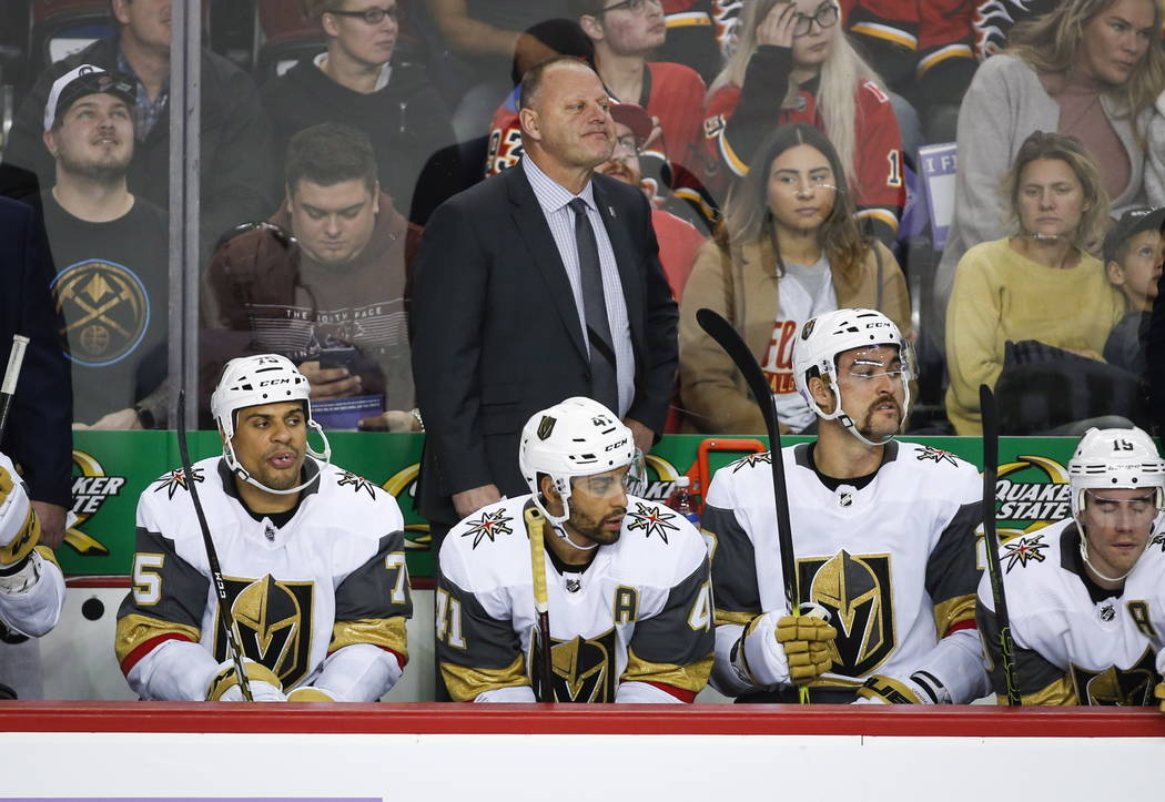 FILE - In this Nov. 19, 2018 file photo Vegas Golden Knights' head coach Gerard Gallant, top center, watches the action during second period NHL hockey game action against the Calgary Flames in Ca ...