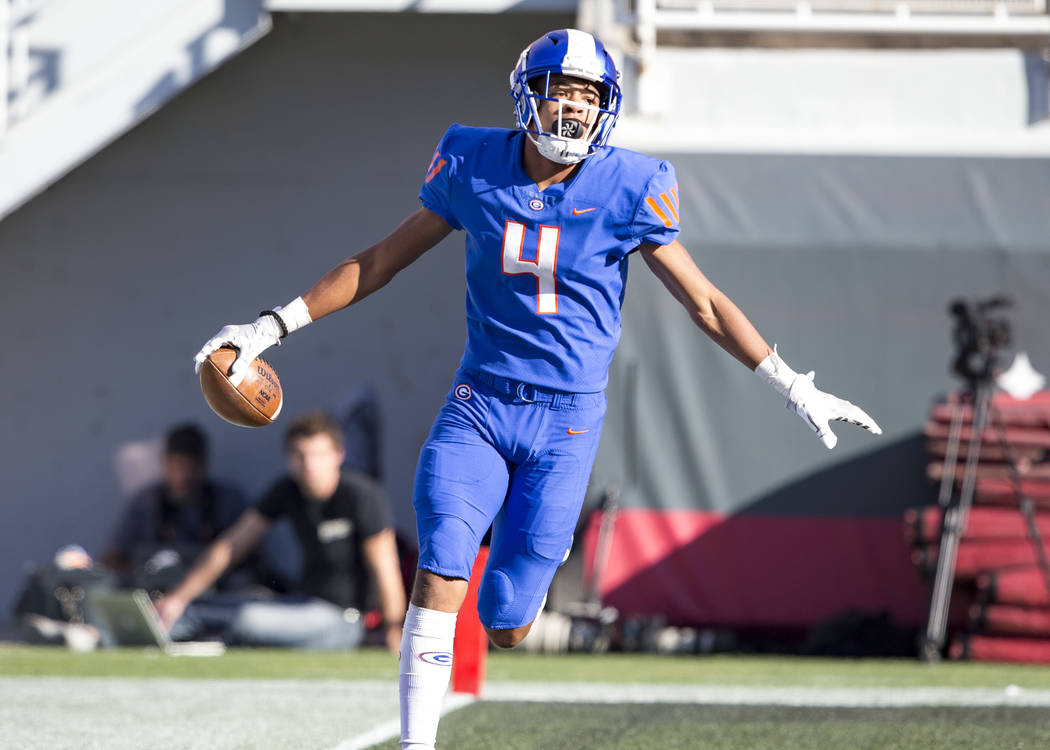 Bishop Gorman wide receiver Rome Odunze (4) reacts after scoring a touchdown against Reno's Bishop Manogue during the first half of the NIAA high school football championship at Sam Boyd Stadium i ...
