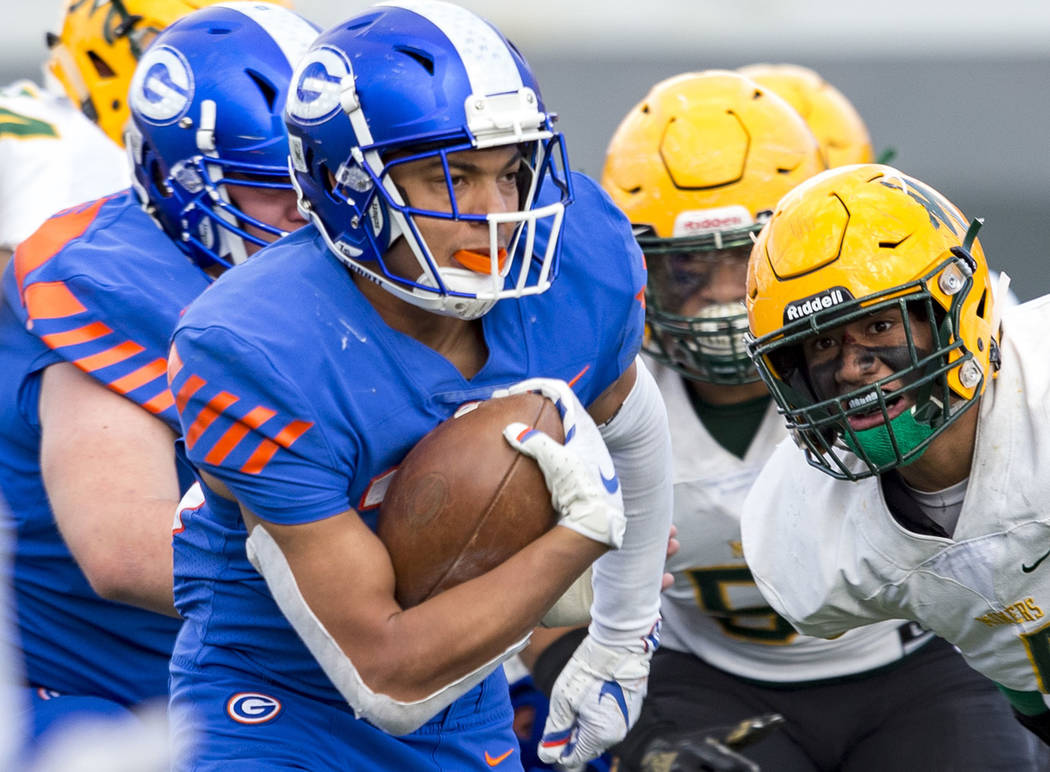 Bishop Gorman running back Amod Cianelli (23) runs for a touchdown past Bishop Manogue defenders during the second half of the NIAA high school football championship at Sam Boyd Stadium in Las Veg ...