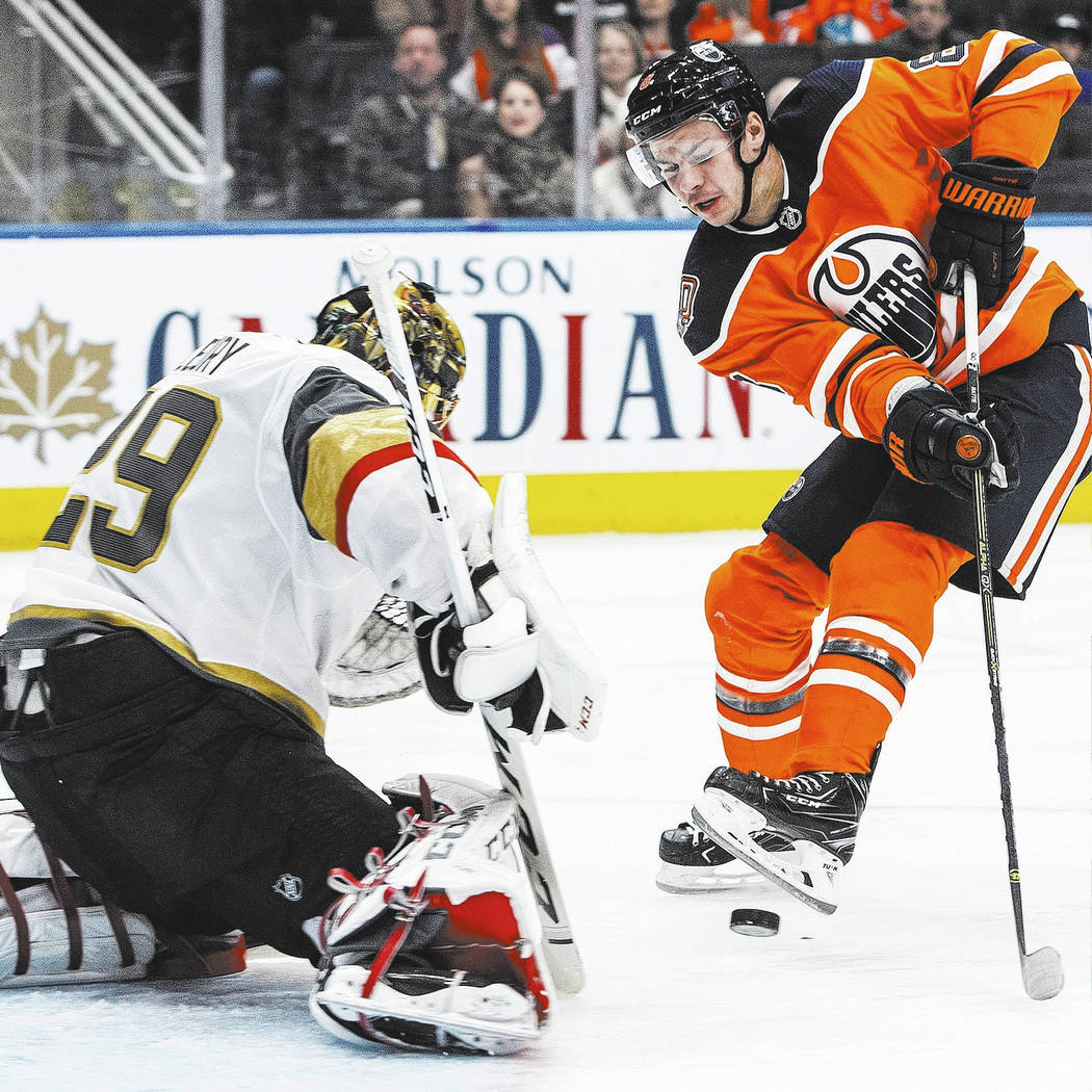 Vegas Golden Knights' goalie Marc-Andre Fleury (29) makes a save on Edmonton Oilers' Ty Rattie (8) during the second period of an NHL hockey game Saturday, Dec. 1, 2018, in Edmonton, Alberta. (Jas ...