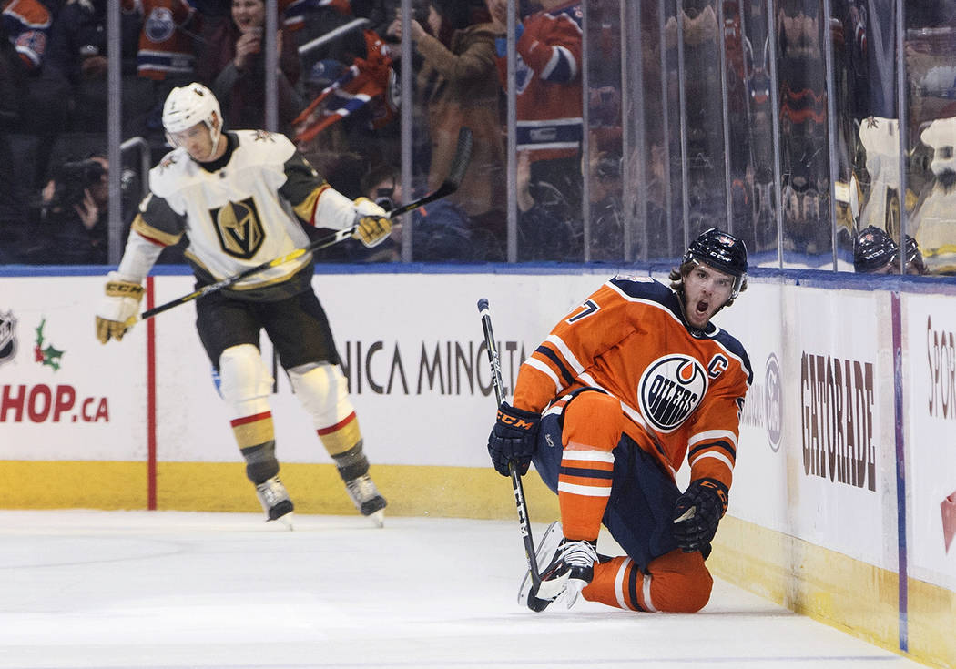 Vegas Golden Knights' Brayden McNabb (3) reacts as Edmonton Oilers' Connor McDavid (97) celebrates a goal during the first period of an NHL hockey game Saturday, Dec. 10, 2018, in Edmonton, Albert ...