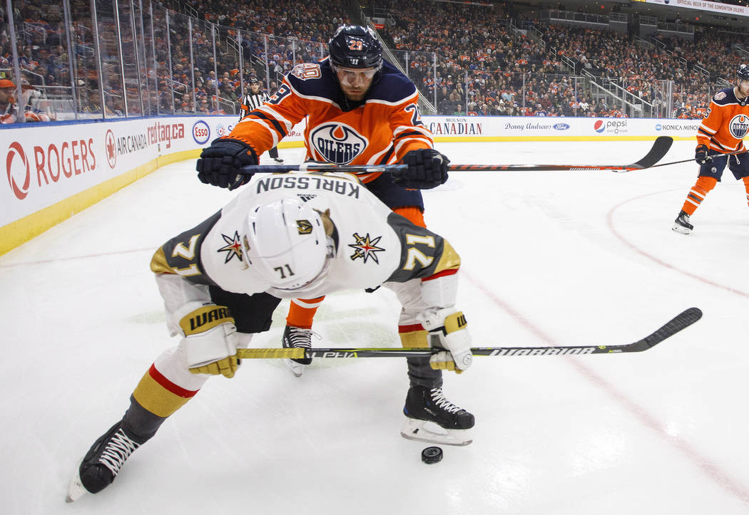 Vegas Golden Knights' William Karlsson (71) is checked by Edmonton Oilers' Leon Draisaitl (29) during the first period of an NHL hockey game Saturday, Dec. 1, 2018, in Edmonton, Alberta. (Jason Fr ...