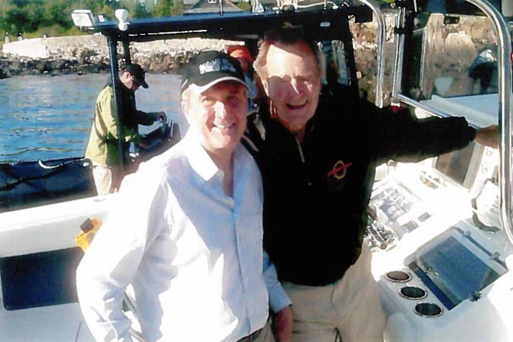 Larry Ruvo and President George H.W. Bush are shown on Bush's yacht in Kennebunkport, Maine, in 2003. Photo provided by Larry Ruvo