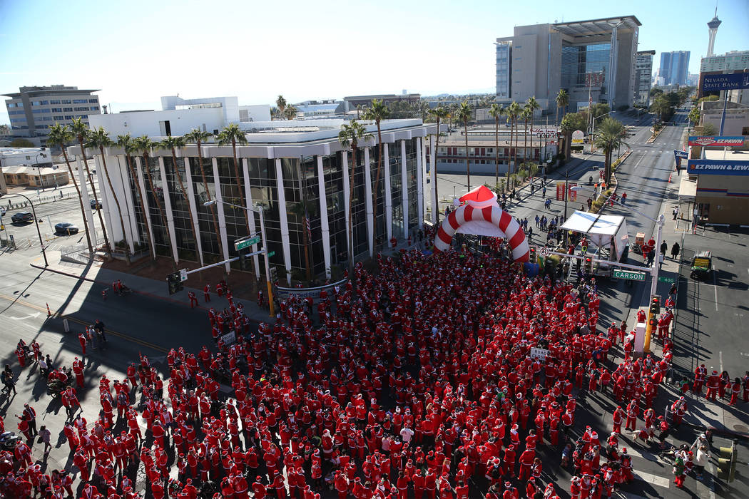 People get ready to start in the 14th annual Las Vegas Great Santa Run at the intersection of South Las Vegas Boulevard and Carson Avenue in Las Vegas, Saturday, Dec. 1, 2018. The event benefits O ...