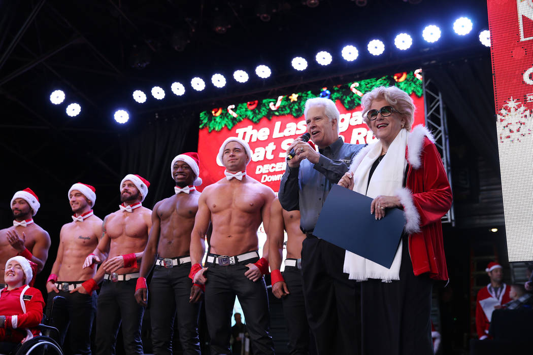 Bob Brown, second from right, president and CEO of Opportunity Village, with Las Vegas Mayor Carolyn Goodman, far right, speak to attendees before the 14th annual Las Vegas Great Santa Run at the ...