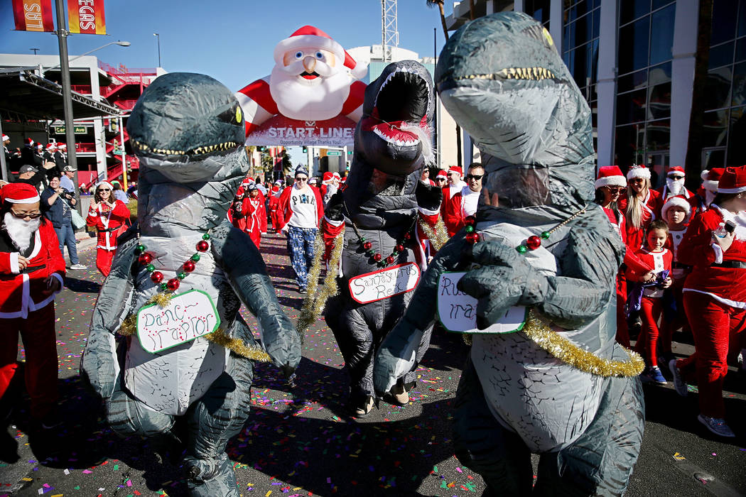 Runners is costumes start in the 14th annual Las Vegas Great Santa Run in downtown Las Vegas, Saturday, Dec. 1, 2018. The event benefits Opportunity Village. Erik Verduzco Las Vegas Review-Journal ...