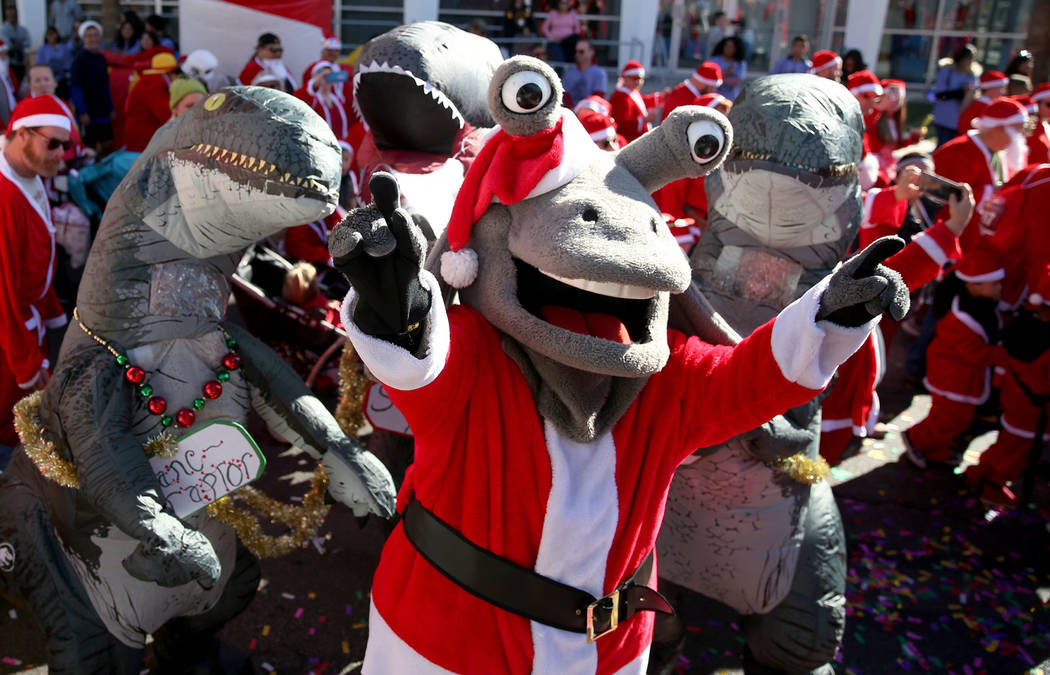 Las Vegas 51's mascot Cosmo cheers as runners start in the 14th annual Las Vegas Great Santa Run in downtown Las Vegas, Saturday, Dec. 1, 2018. The event benefits Opportunity Village. Erik Verduzc ...