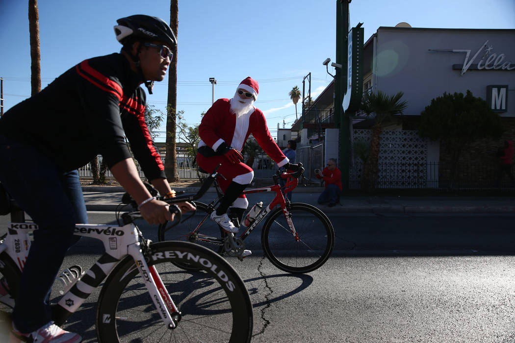 Bicyclists lead runners in the 14th annual Las Vegas Great Santa Run in downtown Las Vegas, Saturday, Dec. 1, 2018. The event benefits Opportunity Village. Erik Verduzco Las Vegas Review-Journal @ ...