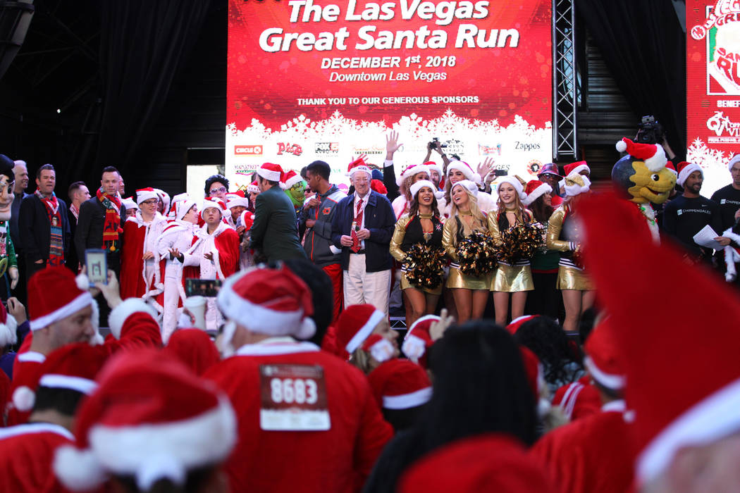 Performers and other event organizers stand of stage before the 14th annual Las Vegas Great Santa Run at the Fremont Street Experience 3rd Street Stage in Las Vegas, Saturday, Dec. 1, 2018. The ev ...