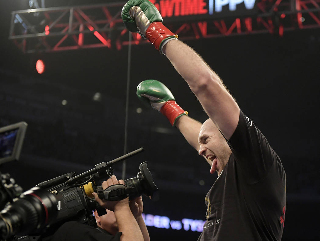 Tyson Fury, of England, mugs for the camera before his WBC heavyweight championship boxing match against Deontay Wilder, Saturday, Dec. 1, 2018, in Los Angeles. (AP Photo/Mark J. Terrill)