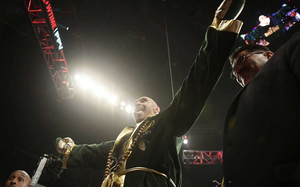 Tyson Fury, of England, gestures to the crowd before his WBC heavyweight championship boxing match against Deontay Wilder, Saturday, Dec. 1, 2018, in Los Angeles. (AP Photo/Mark J. Terrill)