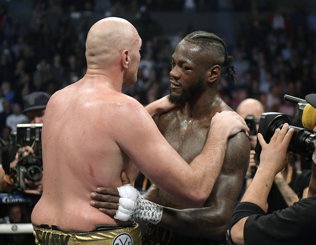 Tyson Fury, left, of England, and Deontay Wilder embrace after their WBC heavyweight championship boxing match, Saturday, Dec. 1, 2018, in Los Angeles. The fight ended in a draw. (AP Photo/Mark J. ...