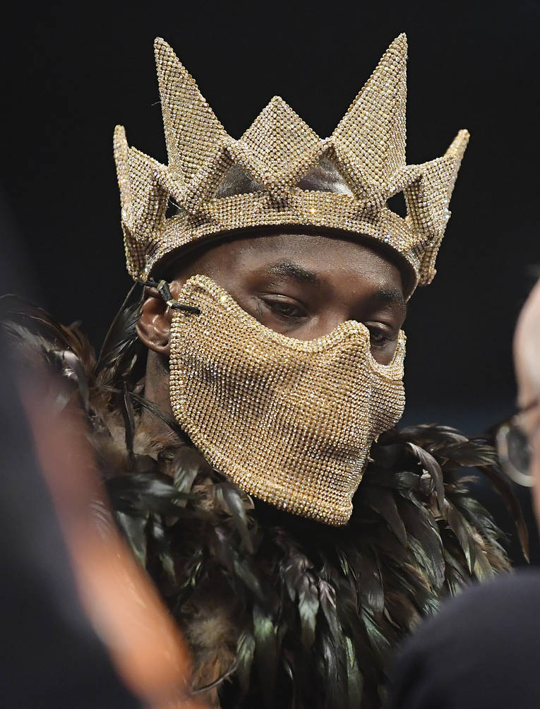 Deontay Wilder wears a mask into the ring before his WBC heavyweight championship boxing match against Tyson Fury, of England, Saturday, Dec. 1, 2018, in Los Angeles. (AP Photo/Mark J. Terrill)