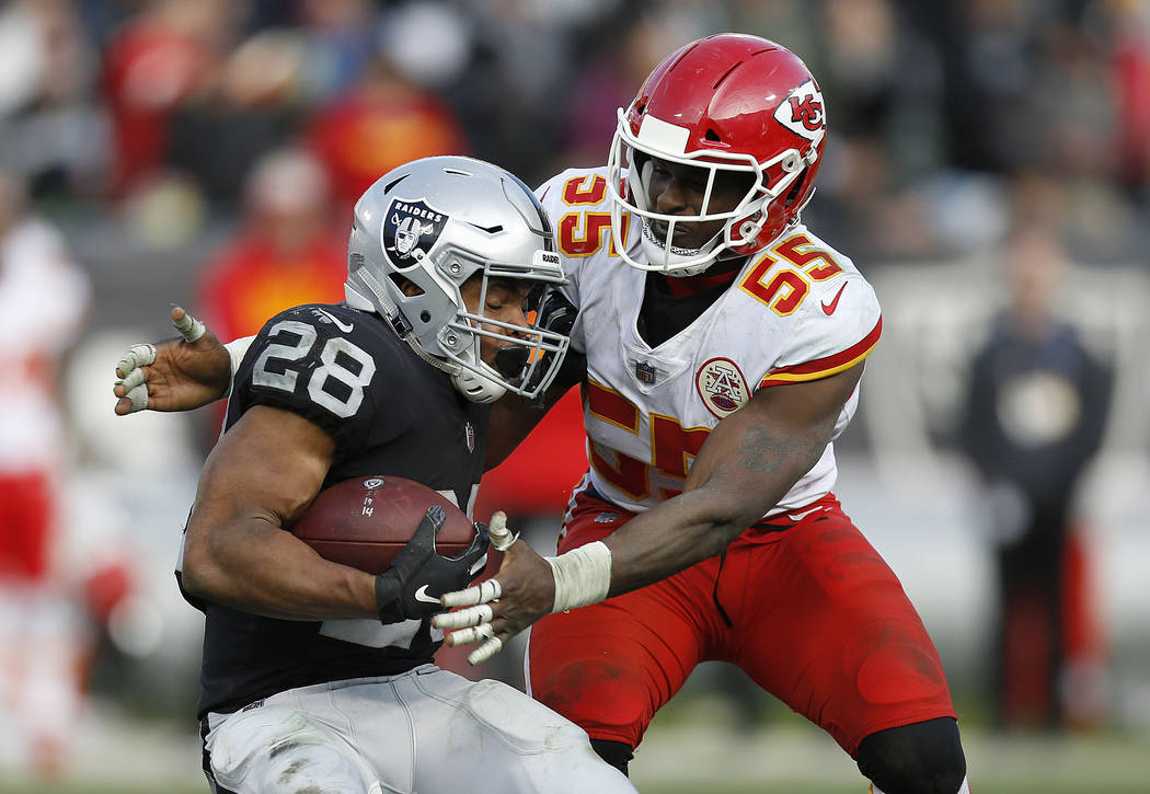 Kansas City Chiefs linebacker Dee Ford (55) tackles Oakland Raiders running back Doug Martin (28) during the second half of an NFL football game in Oakland, Calif., Sunday, Dec. 2, 2018. (AP Photo ...