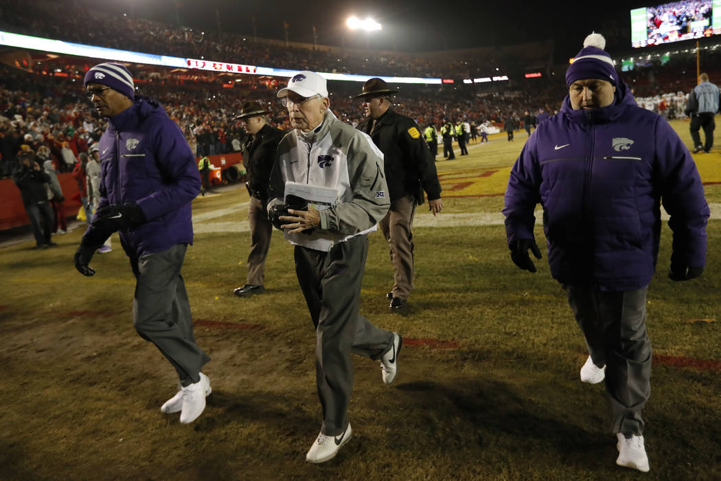 Kansas State head coach Bill Snyder, center, walks off the field after an NCAA college football game against Iowa State, Saturday, Nov. 24, 2018, in Ames, Iowa. Iowa State won 42-38. (Charlie Neib ...