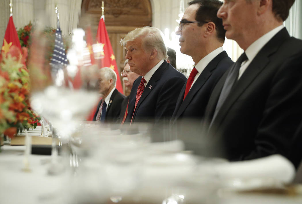 President Donald Trump, center, and Treasury Secretary Steve Mnuchin, second from the right, listen to remarks by China's President Xi Jinping during a bilateral meeting at the G20 Summit, Saturda ...