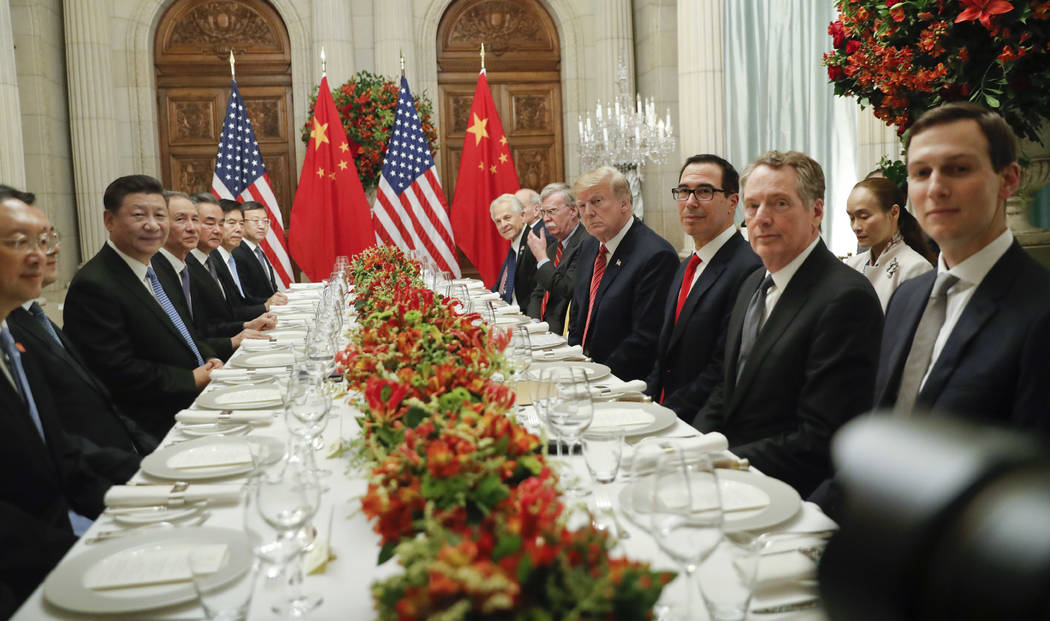 President Donald Trump with China's President Xi Jinping and members of their official delegations during their bilateral meeting at the G20 Summit, Saturday, Dec. 1, 2018 in Buenos Aires, Argenti ...
