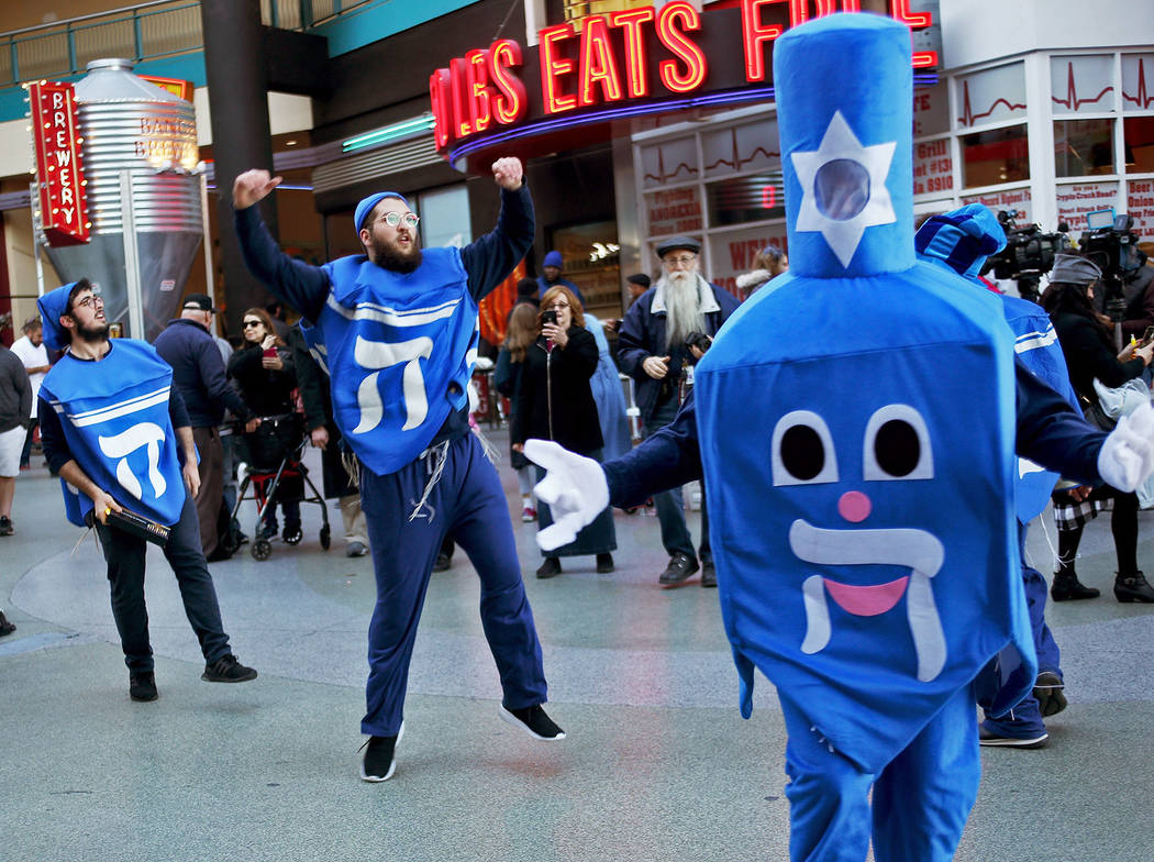 The Dancing Dreidels dance at the Grand Menorah lighting to celebrate the first day of Hanukkah at the Fremont Street Experience in Las Vegas, Sunday, Dec. 2, 2018. Rachel Aston Las Vegas Review-J ...