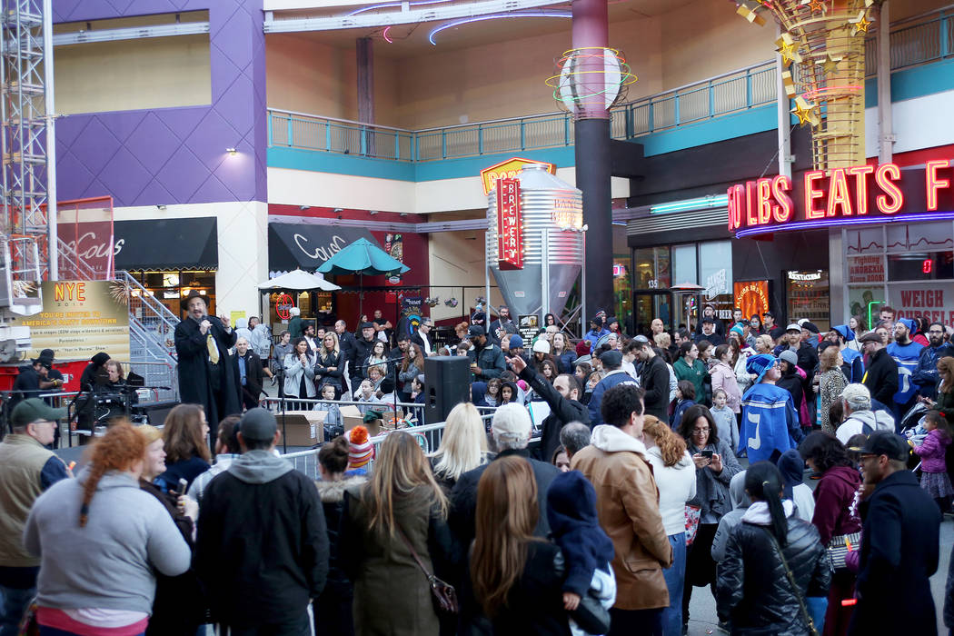Rabbi Shea Harlig talks to the crowd about the importance of Hanukkah at the Grand Menorah lighting to celebrate the first day of Hanukkah at the Fremont Street Experience in Las Vegas, Sunday, De ...