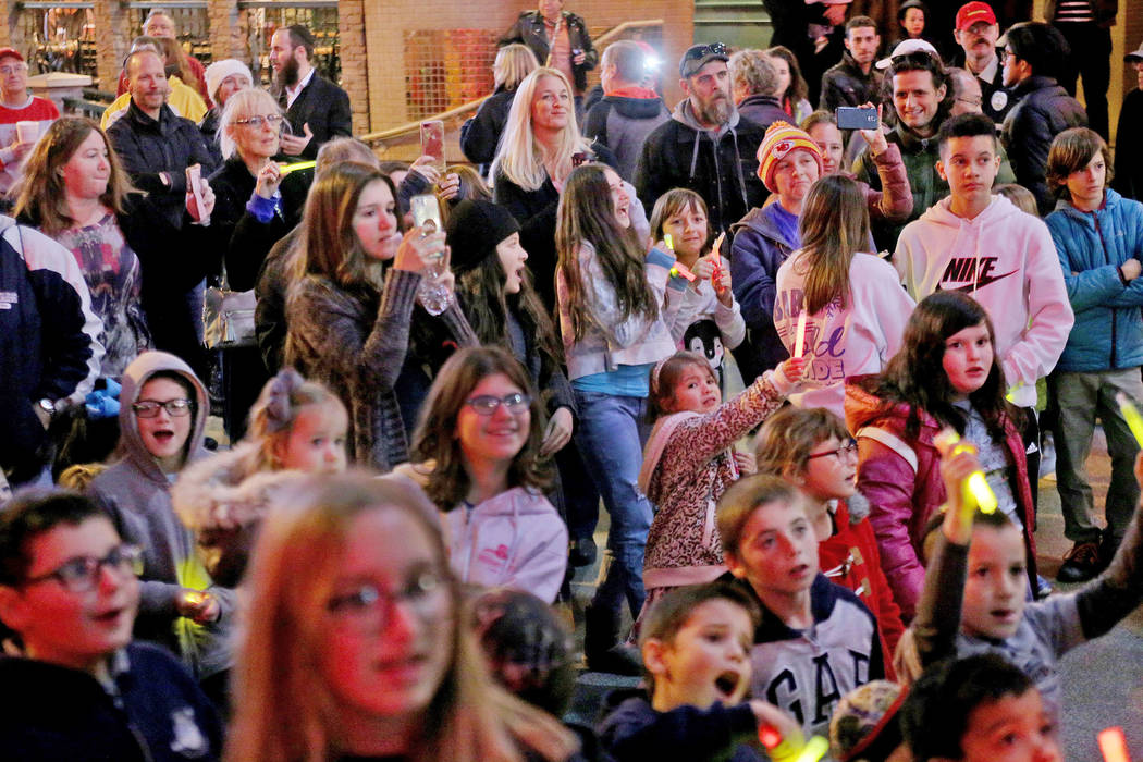 The crowd watches The Dancing Dreidels perform after the Grand Menorah lighting to celebrate the first day of Hanukkah at the Fremont Street Experience in Las Vegas, Sunday, Dec. 2, 2018. Rachel A ...