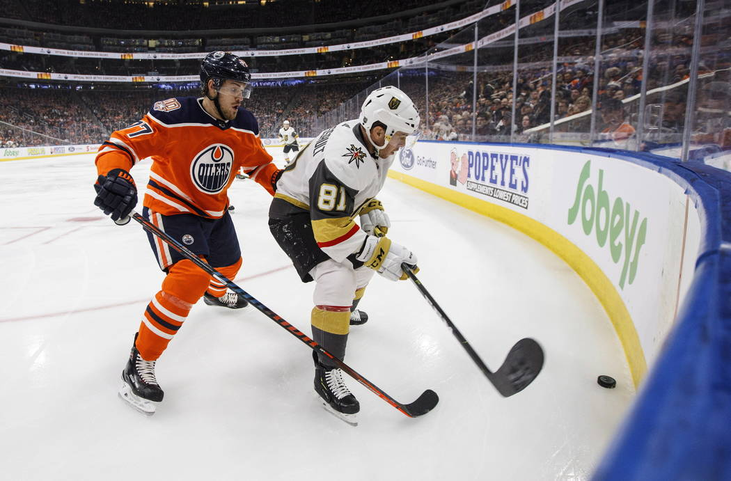 Vegas Golden Knights' Jonathan Marchessault (81) and Edmonton Oilers' Oscar Klefbom (77) battle for the puck during first period NHL action in Edmonton, Alta., on Saturday December 1, 2018. THE CA ...
