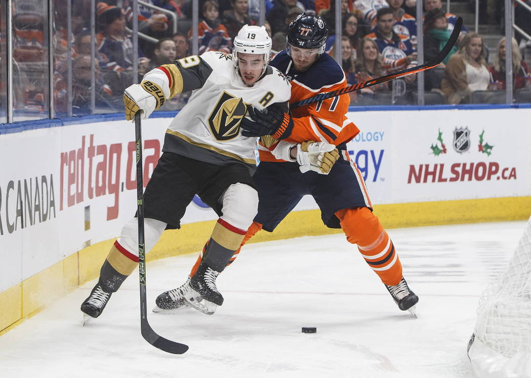 Vegas Golden Knights' Reilly Smith (19) and Edmonton Oilers' Oscar Klefbom (77) compete for the puck during the first period of an NHL hockey game Saturday, Dec. 1, 2018, in Edmonton, Alberta. (Ja ...