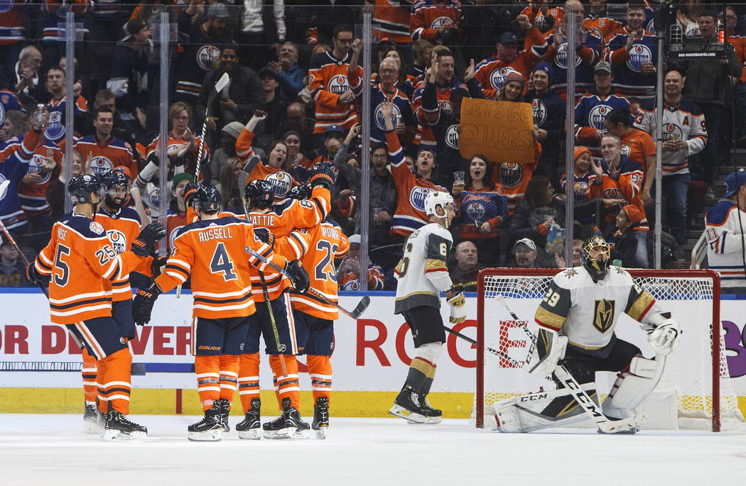 Edmonton Oilers celebrate a goal against the Vegas Golden Knights, as Golden Knights' Colin Miller (6) and goalie Marc-Andre Fleury (29) react during the third period of an NHL hockey game Saturda ...