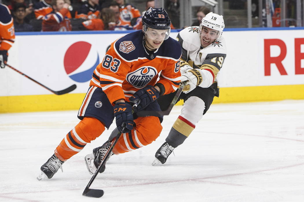 Vegas Golden Knights' Reilly Smith (19) chases down Edmonton Oilers' Matthew Benning (83) during the third period of an NHL hockey game Saturday, Dec. 1, 2018, in Edmonton, Alberta. (Jason Franson ...