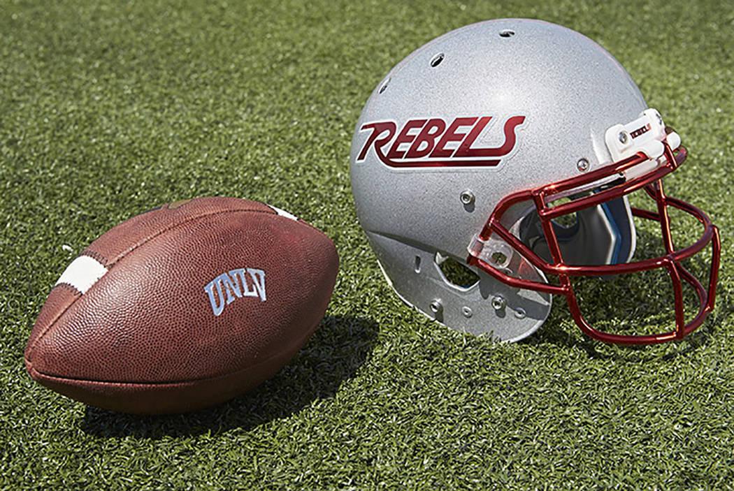 UNLV football helmet and ball (R. Marsh Starks / UNLV Creative Services)