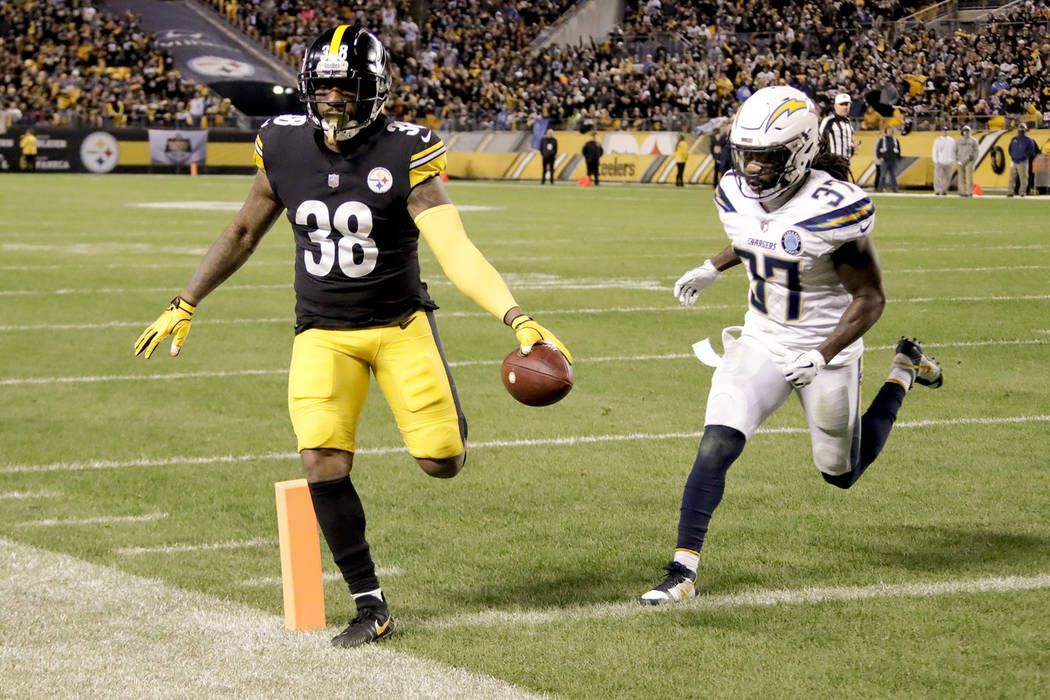 Pittsburgh Steelers running back Jaylen Samuels (38) beats Los Angeles Chargers strong safety Jahleel Addae (37) to the end zone for a touchdown in the second half of an NFL football game, Sunday, ...