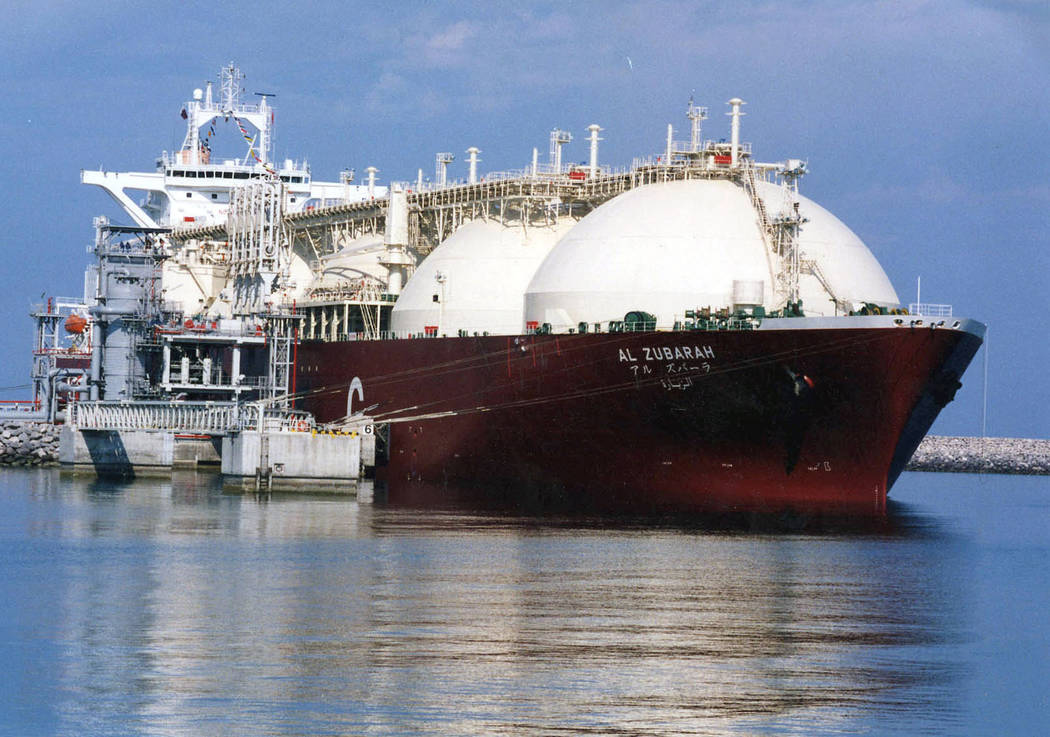 This undated file photo shows a Qatari liquid natural gas (LNG) tanker ship being loaded up with LNG at Raslaffans Sea Port, northern Qatar. The tiny, energy-rich Arab nation of Qatar announced on ...